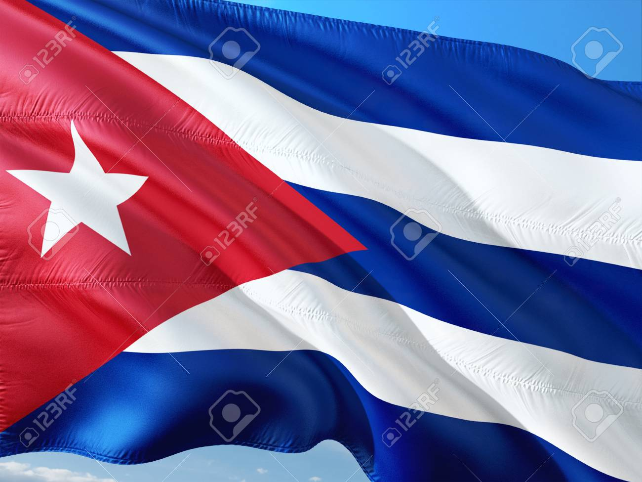 Flag of Cuba waving in the wind against deep blue sky. High quality fabric. - 114290734