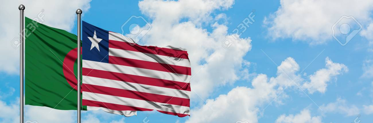 Algeria and Liberia flag waving in the wind against white cloudy