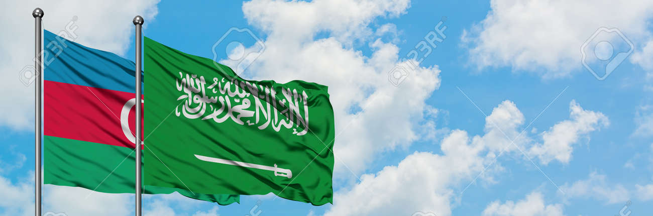 Azerbaijan and Saudi Arabia flag waving in the wind against white cloudy blue sky together. Diplomacy concept, international relations. - 123072093