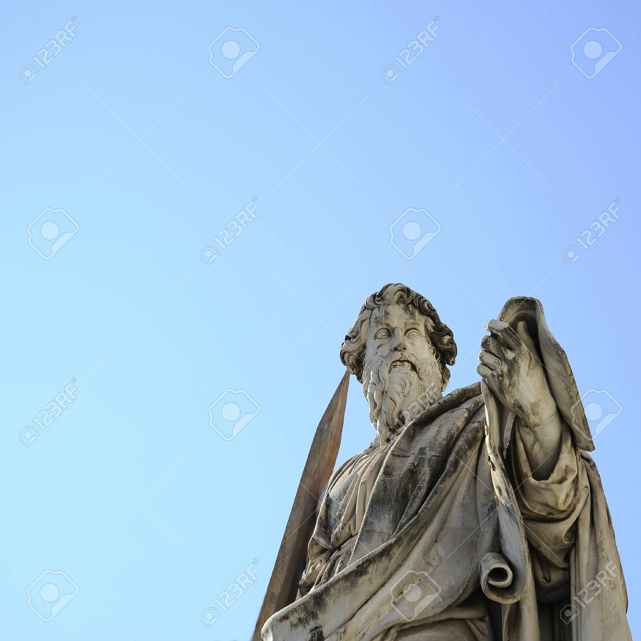 The statue of St. Paul backed by blue sky, Vatican City (Rome, Italy). - 113517285