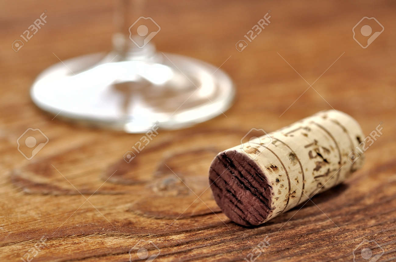 Cork and glass of italian red wine on a table in oak, closeup, selective focus Stock Photo - 16675084