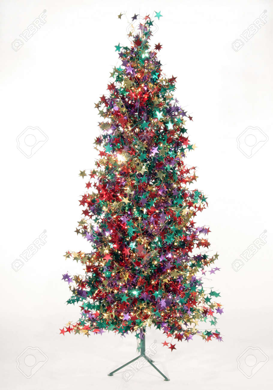 Foil Christmas Tree.A Christmas Tree Made Of Multicolored Foil Stars Sits On A White
