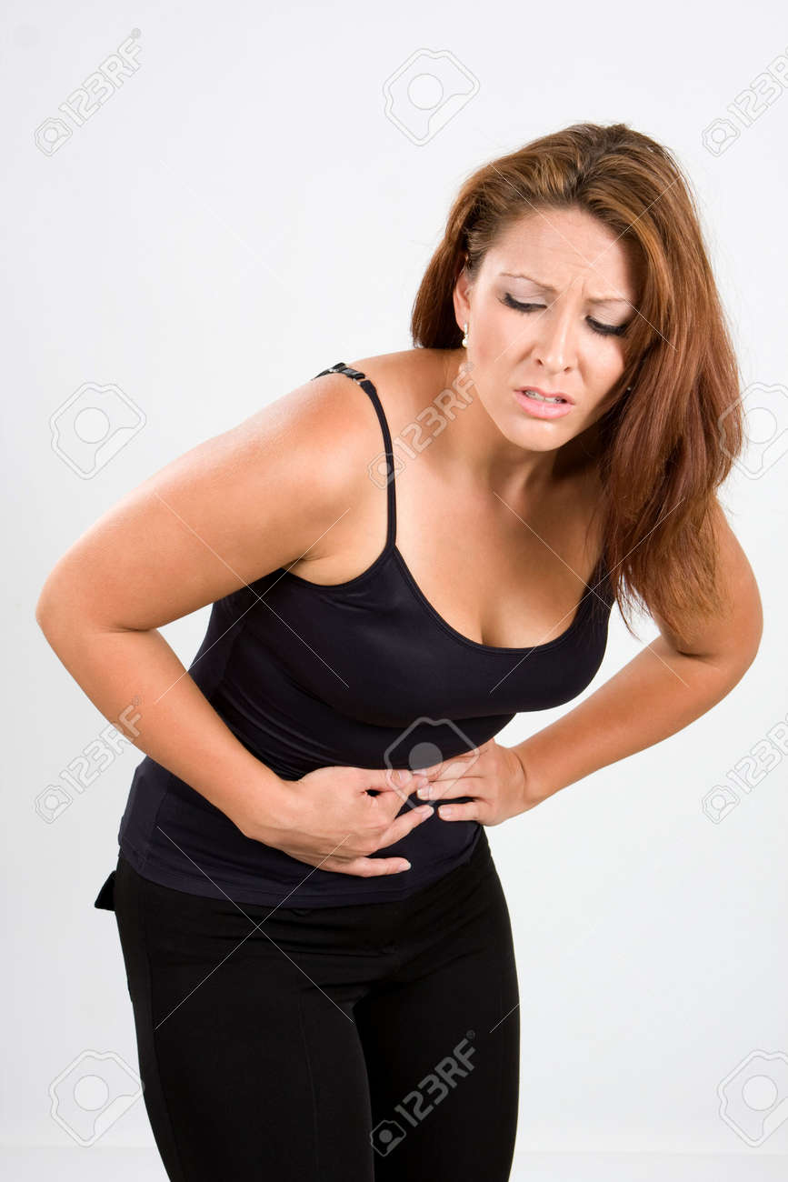 Woman bends over in pain for stomach cramps. Stock Photo - 6017433
