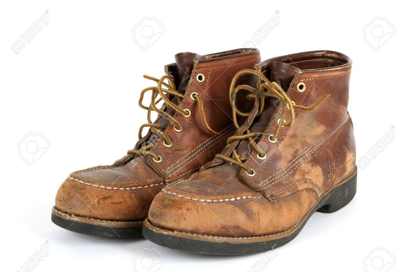 Pair of old steel toed shoes in very used condition. Stock Photo - 7383919