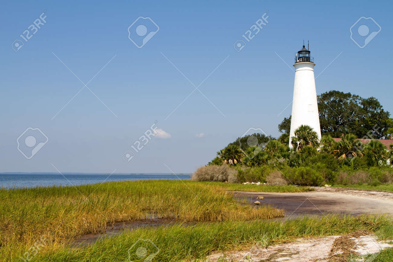 Florida's St. Marks Lighthouse on the Gulf of Mexico coast against a blue sky. Stock Photo - 10747504
