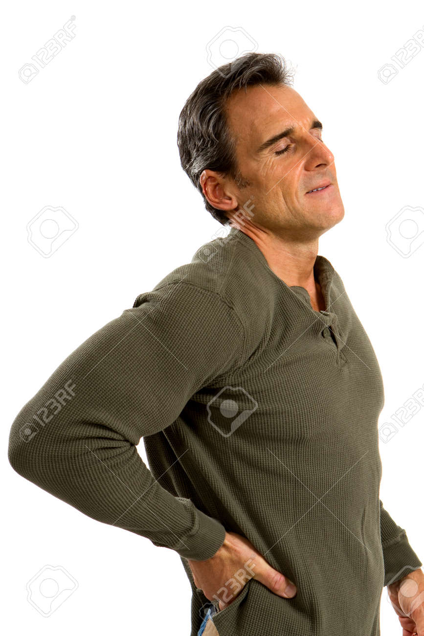 Man holds his back trying to relieve his backache. Stock Photo - 11536771