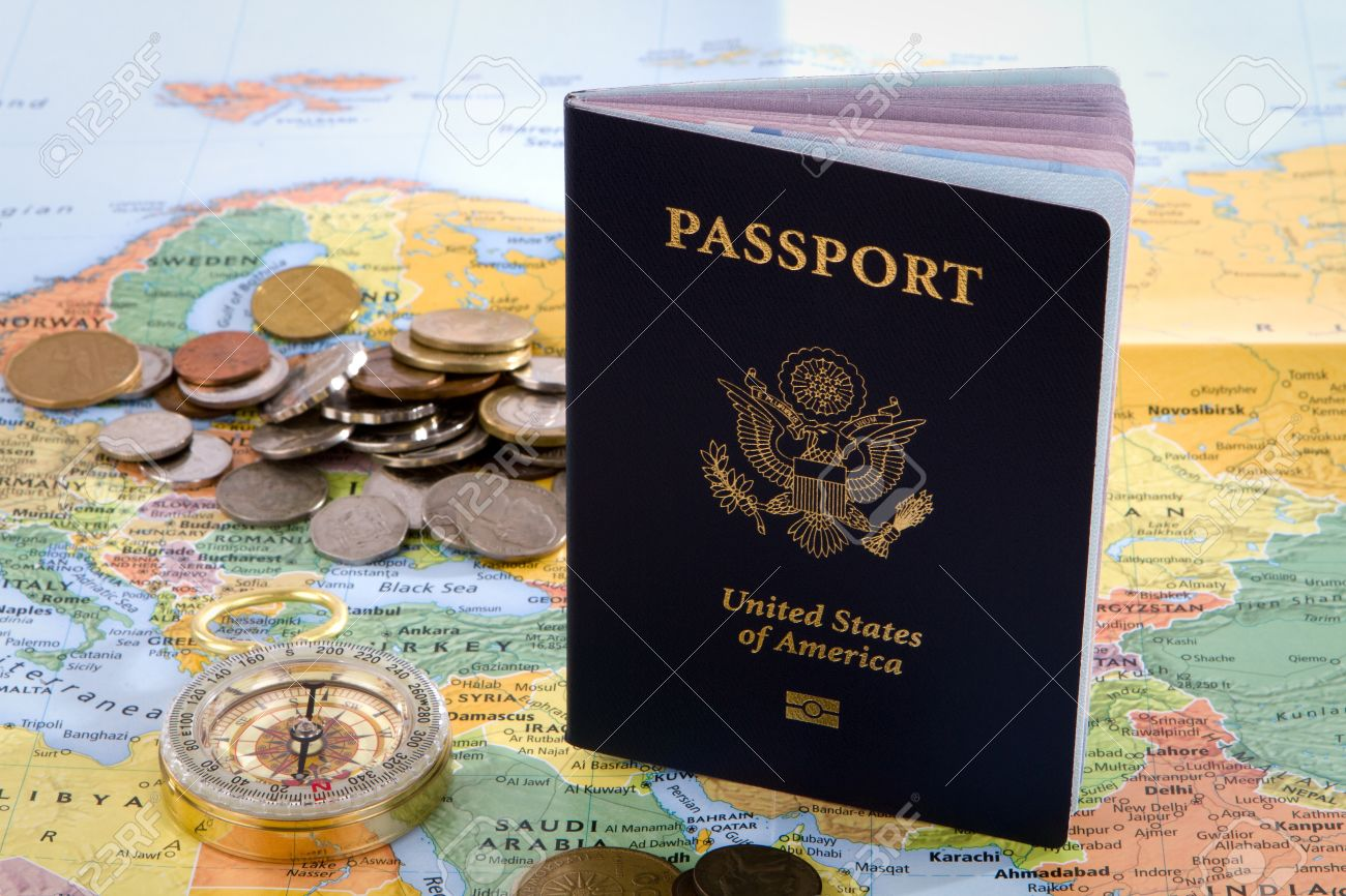 USA Passport Compass And Foreign Coins Sit On A Map Of Europe - Travel europe from us map