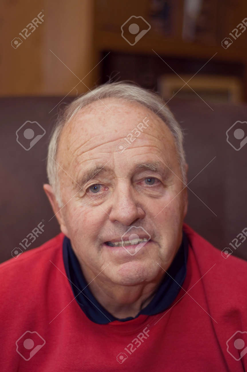 Senior Man sitting in a Lazy boy chair at home Stock Photo - 6110252