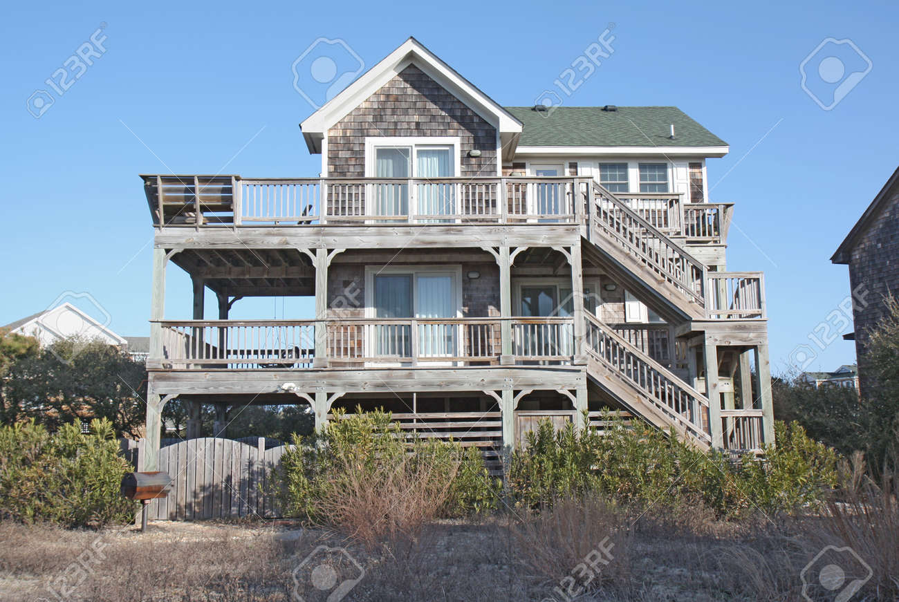A beach house on the Outer Banks at Nags Head, North Carolina, against a bright blue sky Stock Photo - 10370031