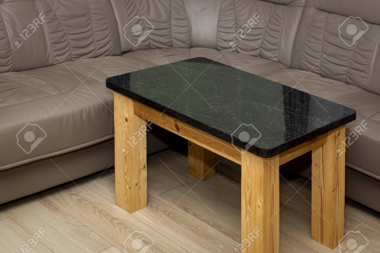 - Empty Rustic Table Made Of Polished Granite By A Soft Leather