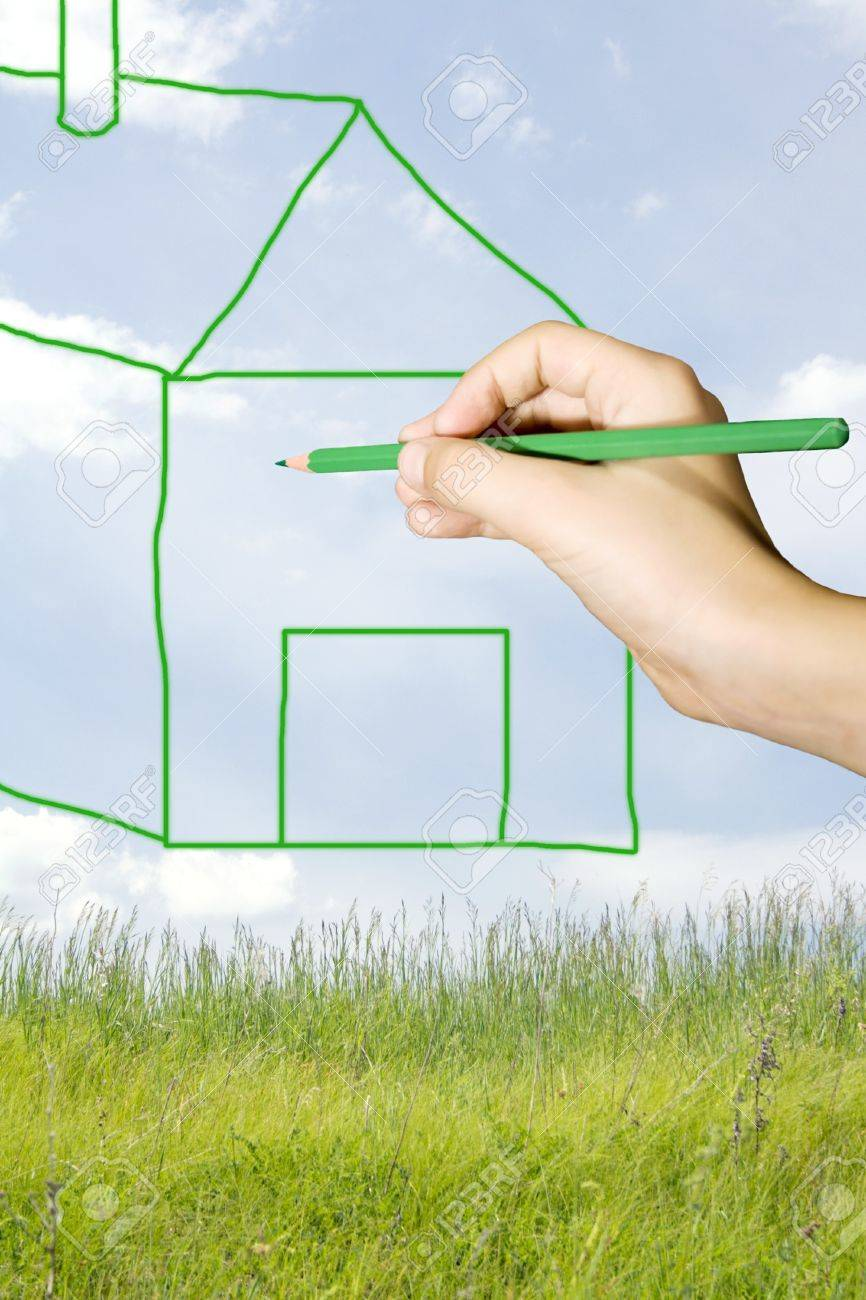 Young boy draw a house on a beautiful lawn Stock Photo - 8189944