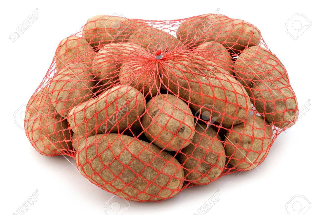 A Red Mesh Bag Of Russet Potatoes Stock Photo