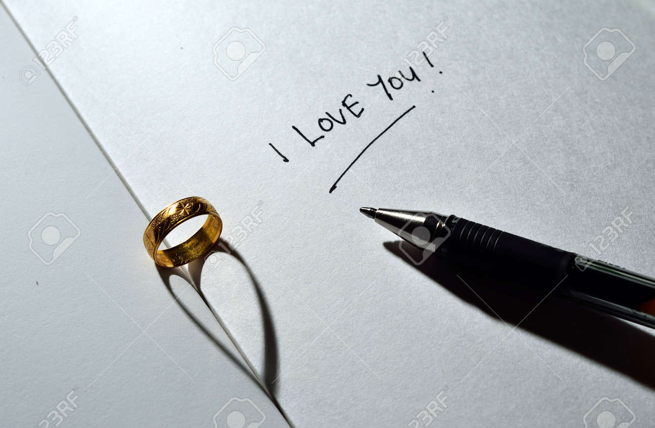 Ring with heart shadow and I love you text with pen Stock Photo - 19178564