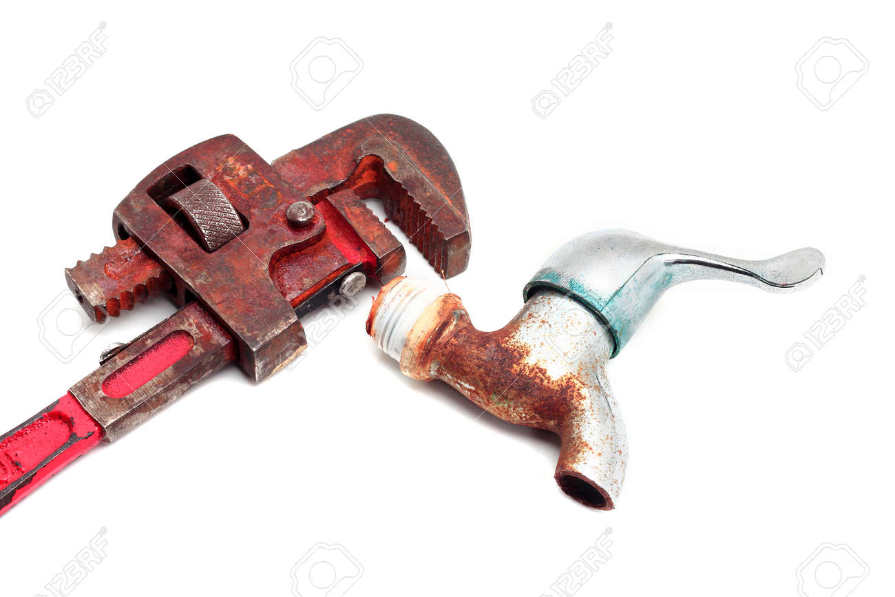 Dirty and rusty pipe wrench with taps Stock Photo - 27639962
