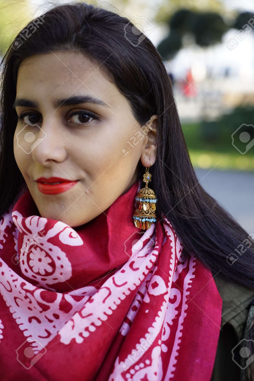 beautiful girl with Eastern Turkish headscarves and gold antique