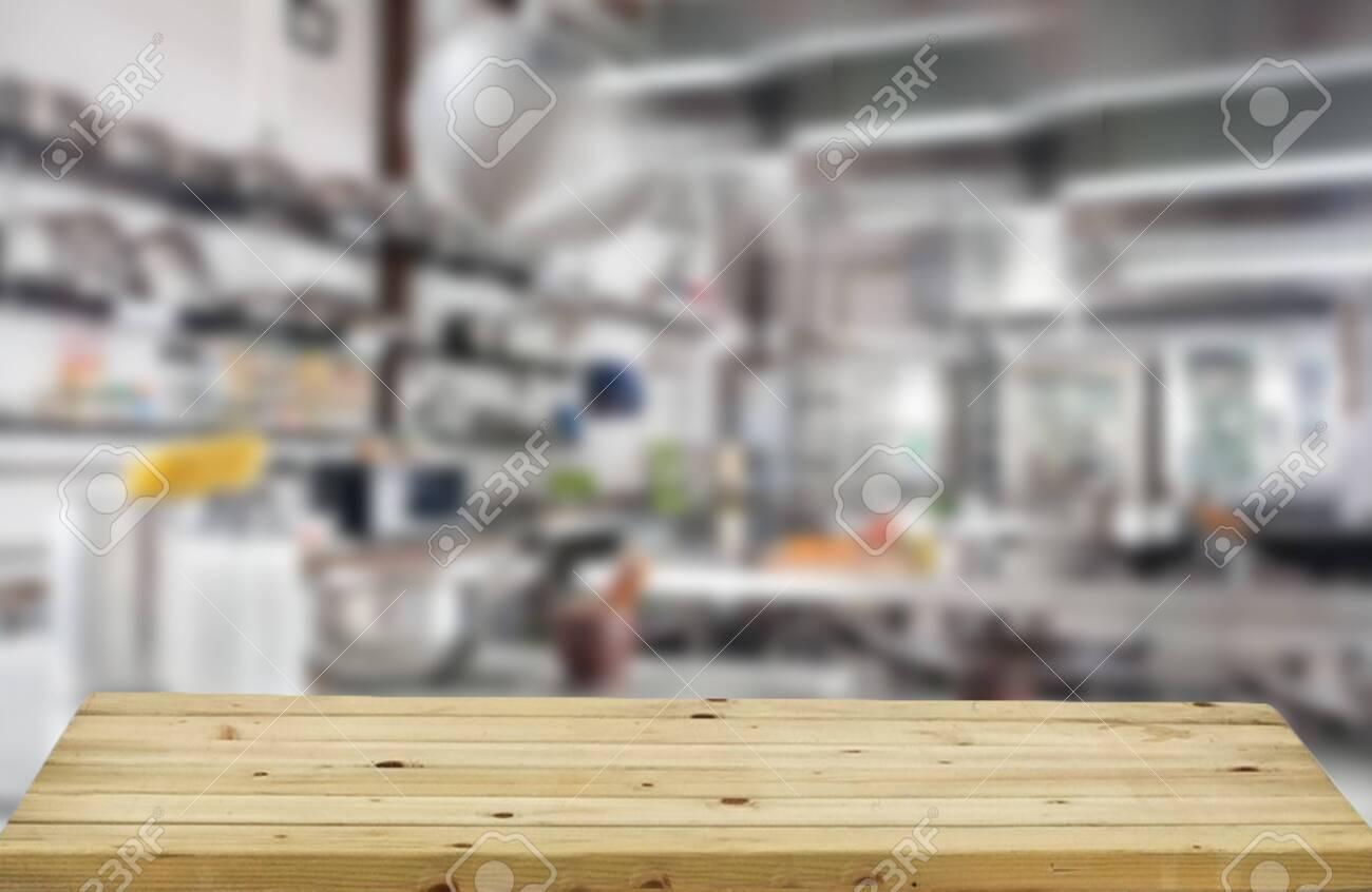 Blurred background of white kitchen furniture and kitchen desk..