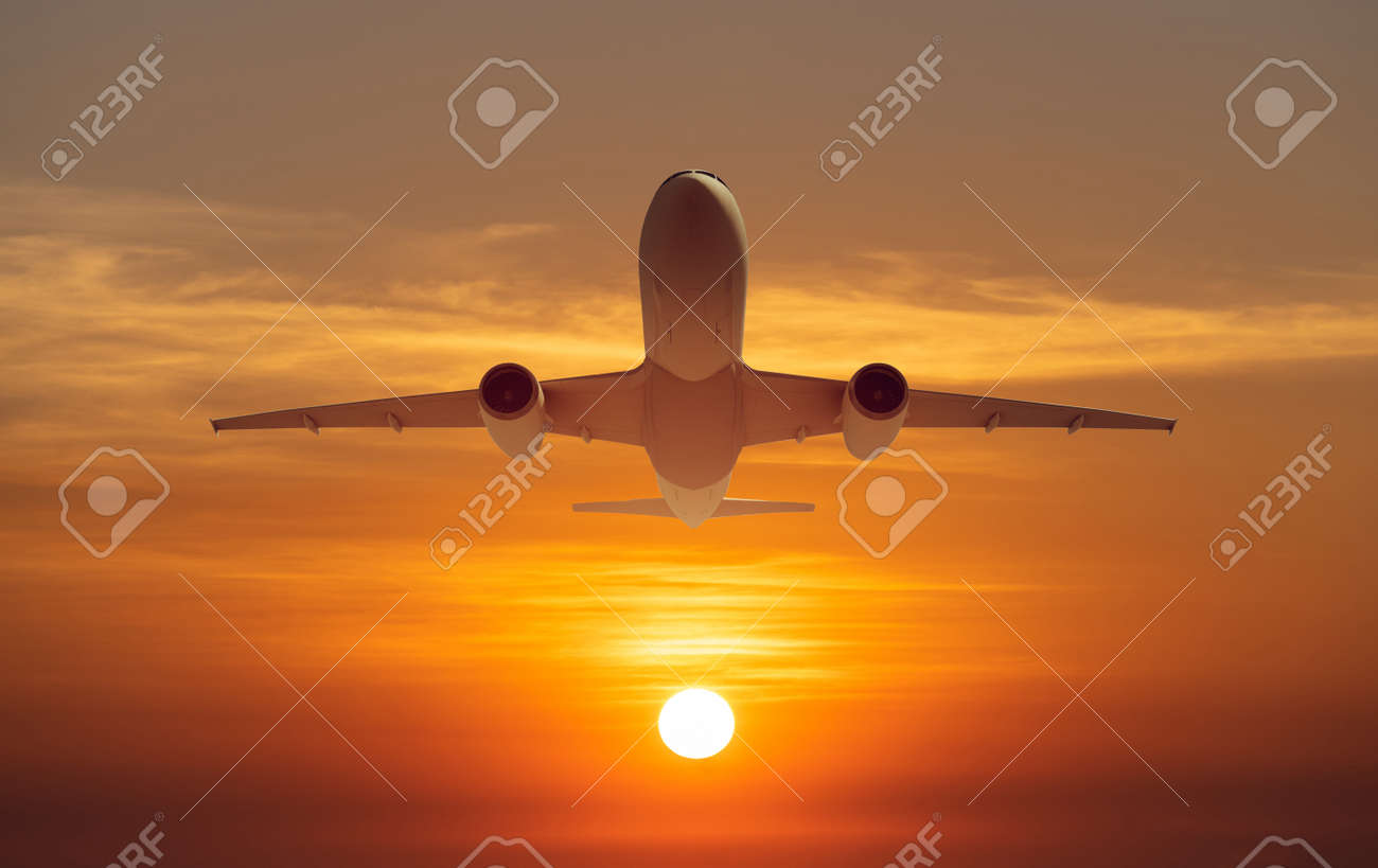 passenger plane fly up over take-off runway from airport at sunset, sunrise - 128831891