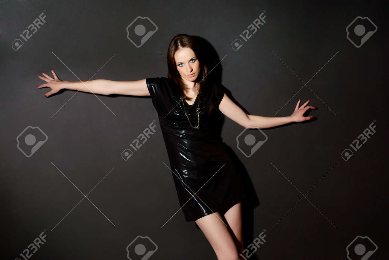 Portrait of a woman on a dark background. Studio shot. Stock Photo - 7656367
