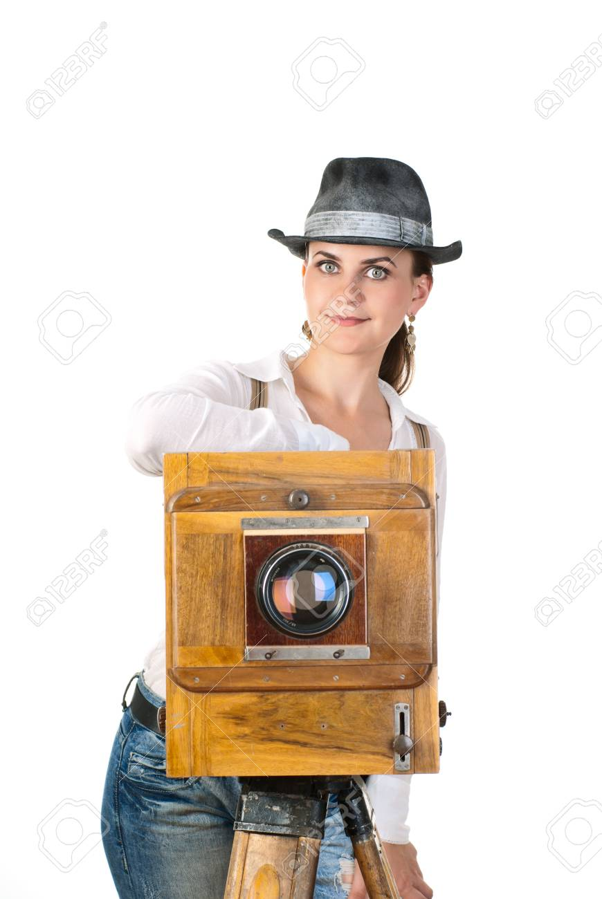 Young sexy woman with an old photo camera. White background. Studio shot. Stock Photo - 8492993