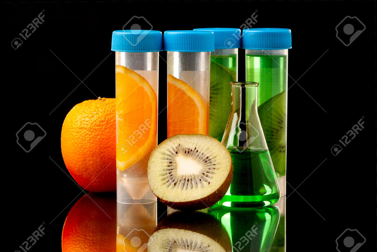 Lb tubes filed with liquid of with fruits parts on black background. Stock Photo - 19152870