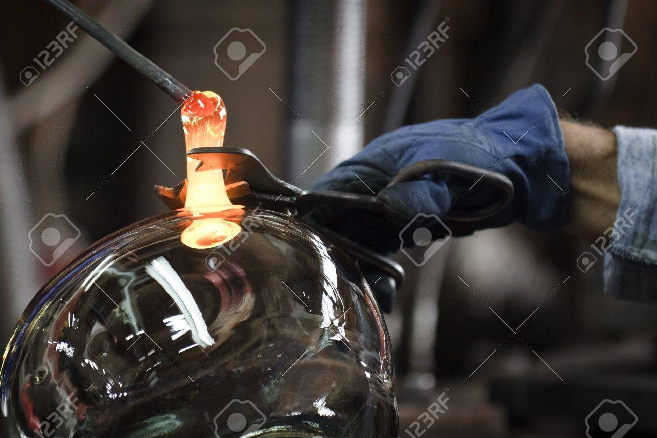 Glassmaker in factory creates bowl glass Stock Photo - 10555045