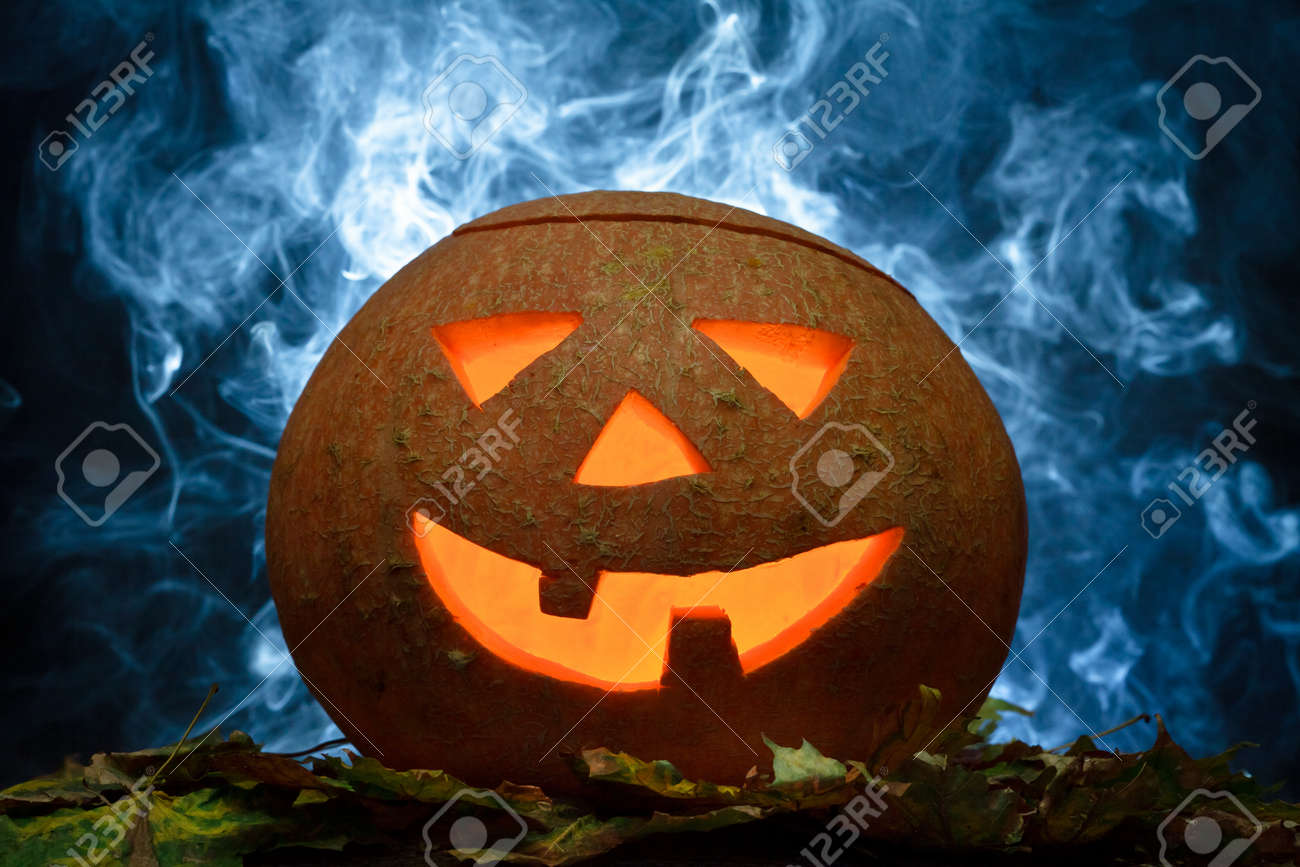 Halloween pumpkin on leafs with blue smoke Stock Photo - 10640612