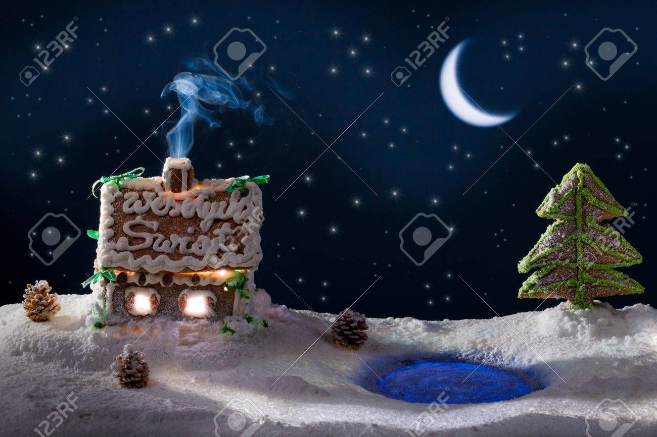 Small gingerbread cottage in the village at the lake Stock Photo - 11429584