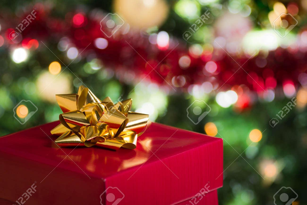 Open christmas gift on christmas tree background open christmas gift on christmas tree background 11429601 negle Gallery