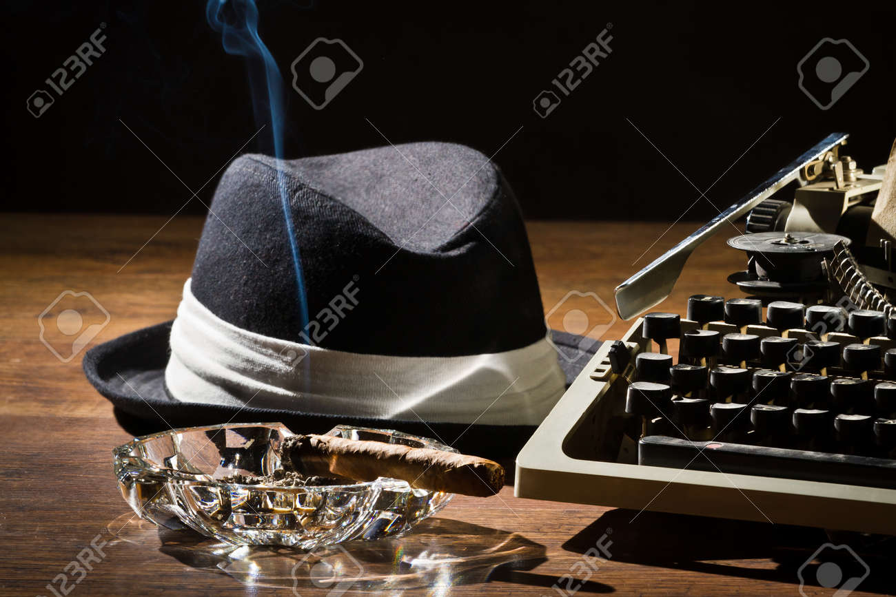 Old manual typewriter cigar and hat Stock Photo - 12583160