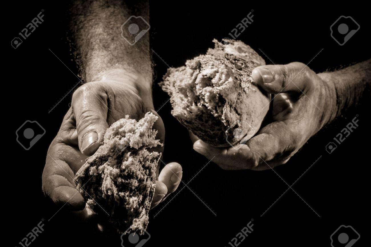 The sharing of bread as a concept of helping the poor Stock Photo - 12583624