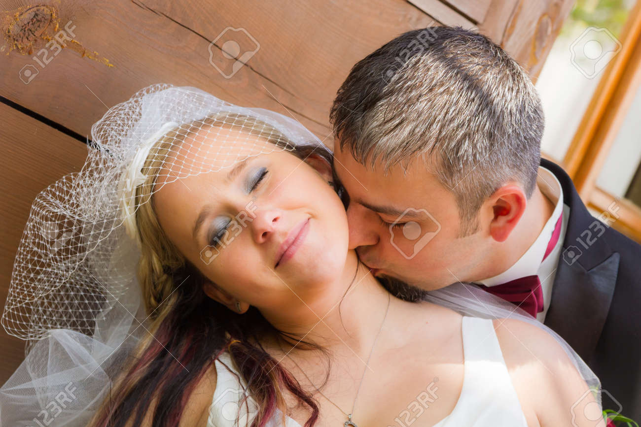 Close up of groom kissing the bride Stock Photo - 14119479