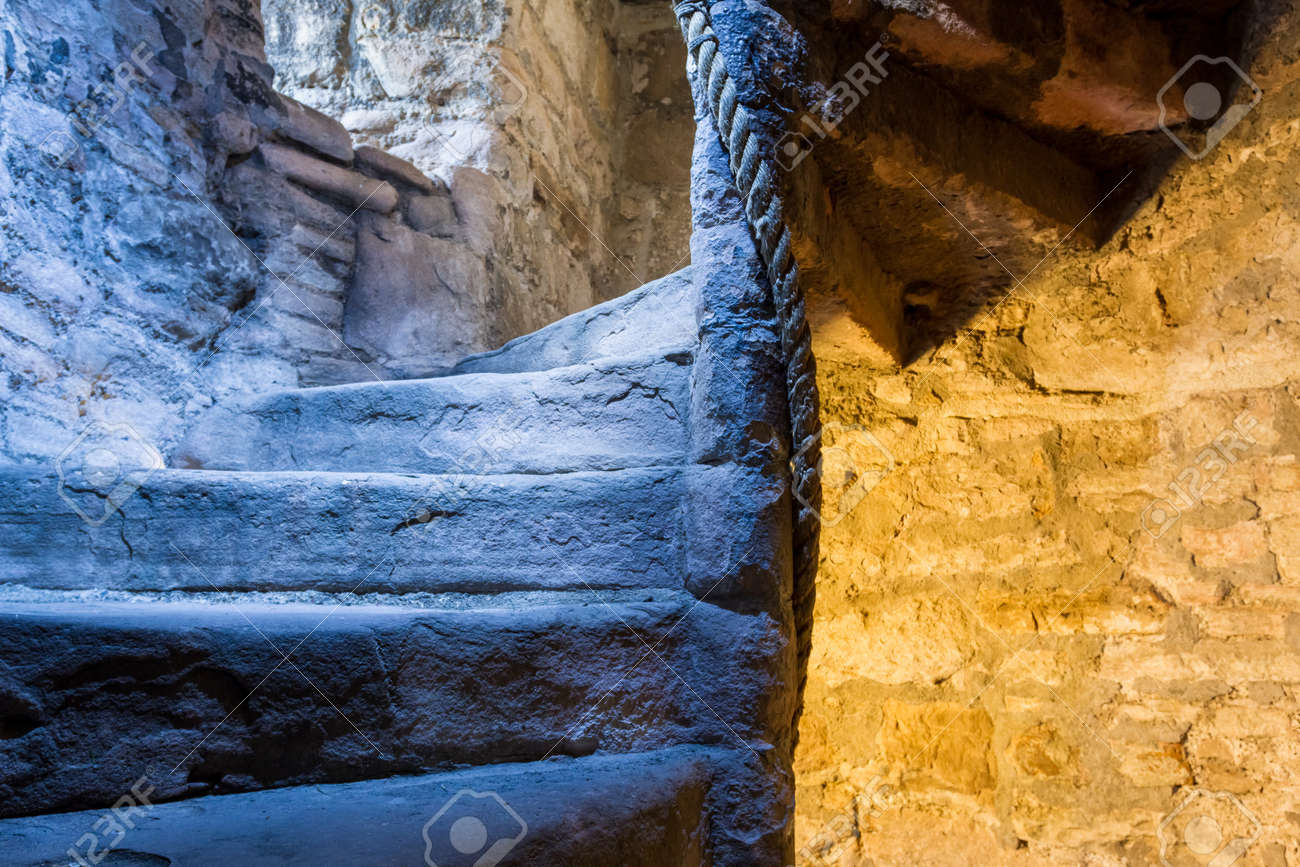 Lighted stone staircase in a medieval castle Stock Photo - 15324525