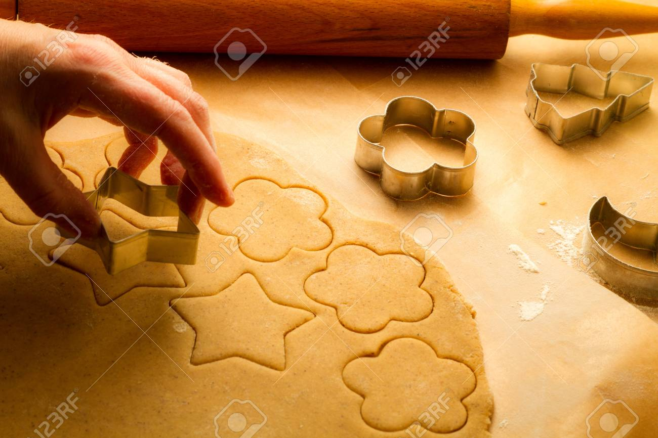 Cutting of homemade Christmas cookies on baking paper Stock Photo - 16272362