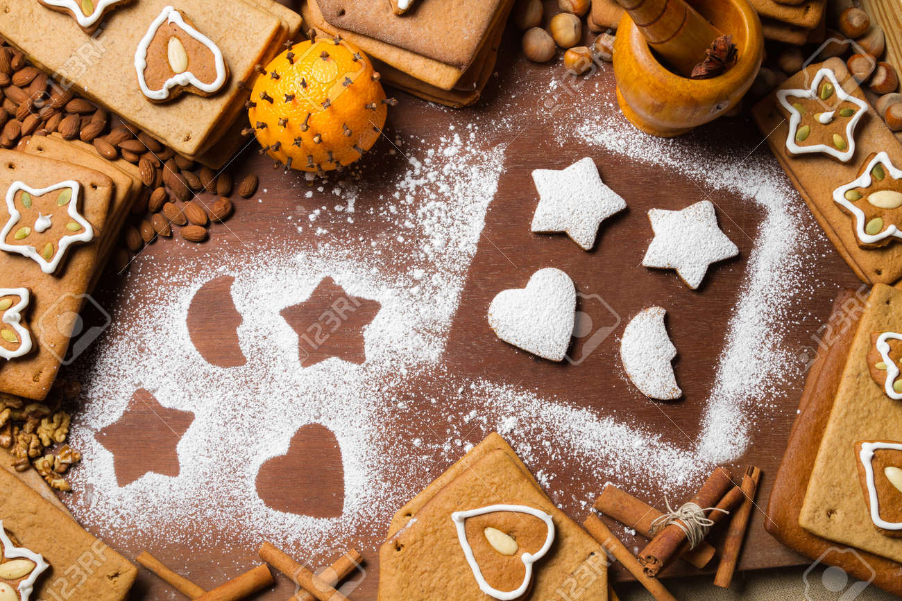 Christmas frame made up of gingerbread cookies and nuts Stock Photo - 16397572