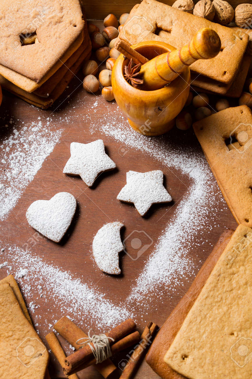 Decorating gingerbread cookies on old wooden table Stock Photo - 16397550