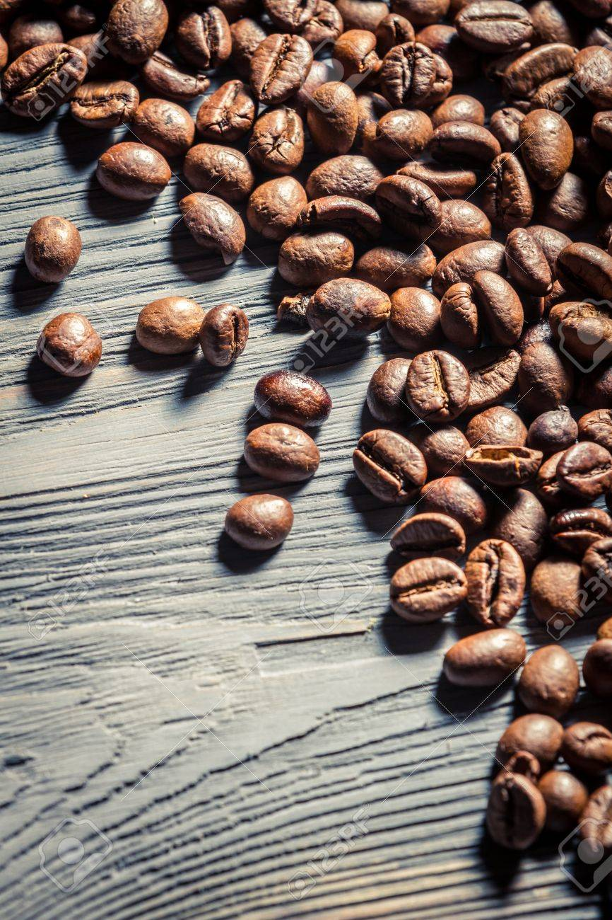 Coffee seed on wooden table background no. 2 Stock Photo - 16397642
