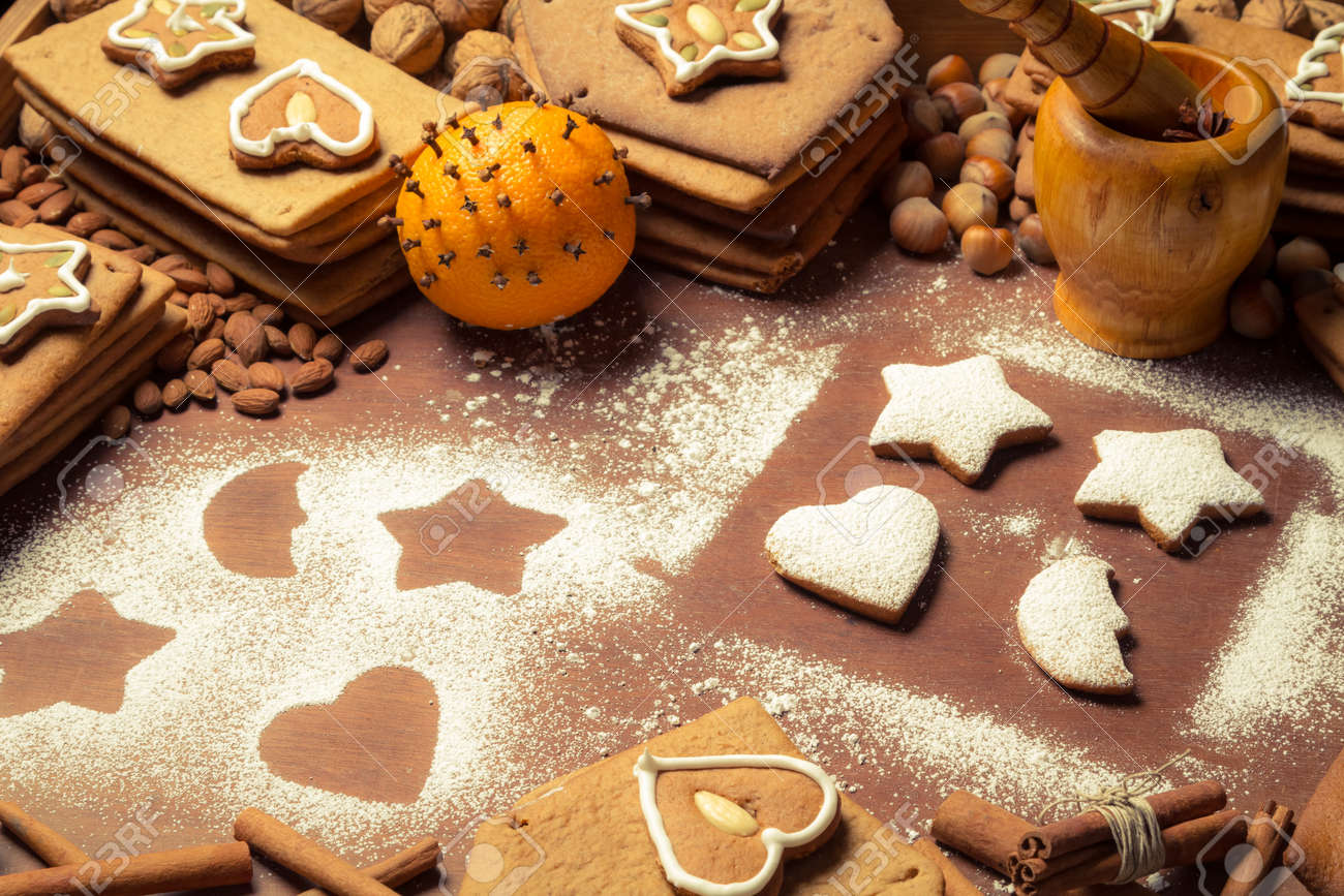 Christmas frame made up of gingerbread cookies and nuts Stock Photo - 16824263