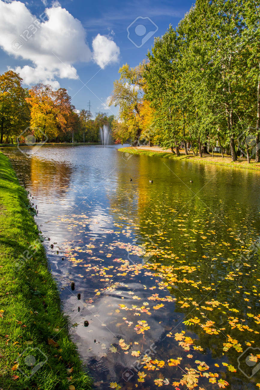 Autumn park and blue sky reflecting on river Stock Photo - 16824358