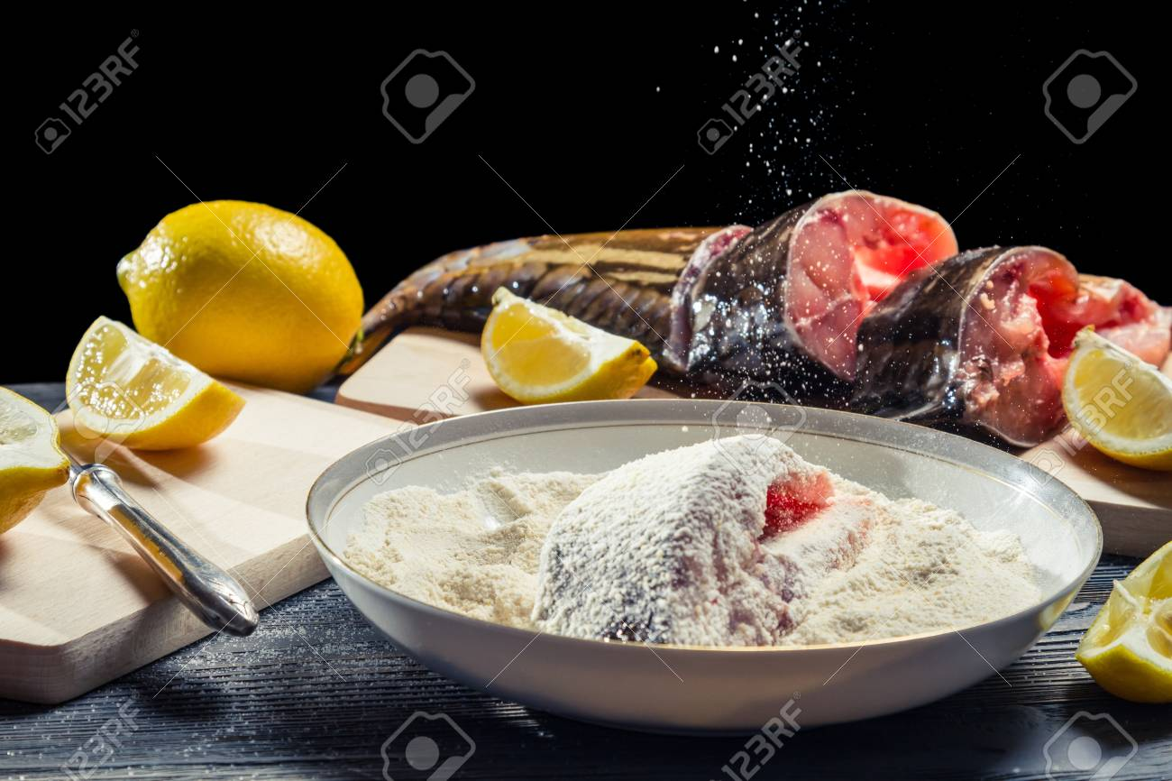 Fresh fish sprinkled with flour before frying Stock Photo - 17088757