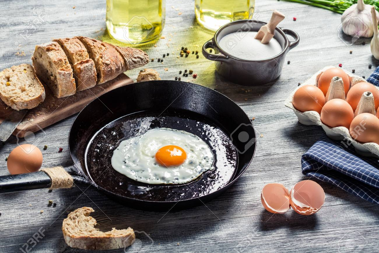Closeup of frying eggs and fresh bread Stock Photo - 18268774