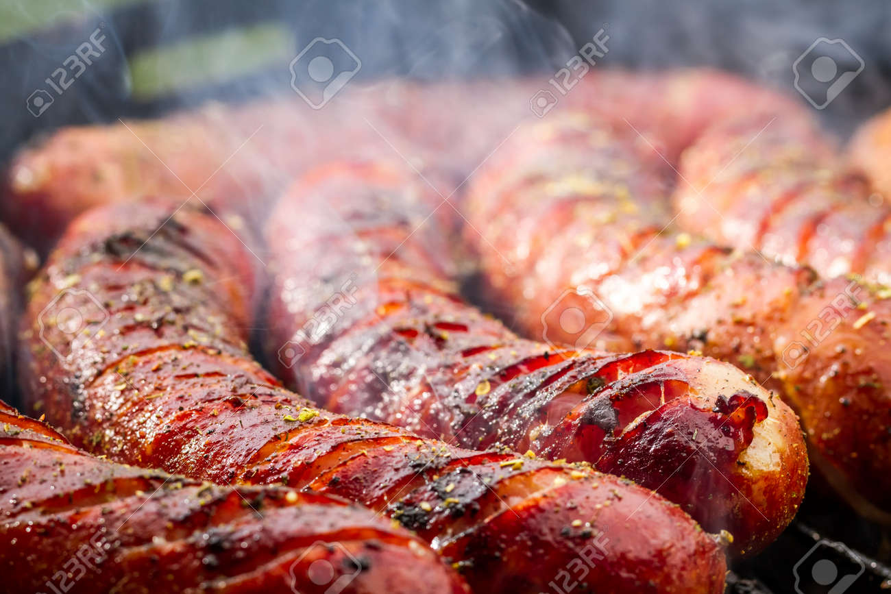 Closeup of sausage on the grill - 21730902