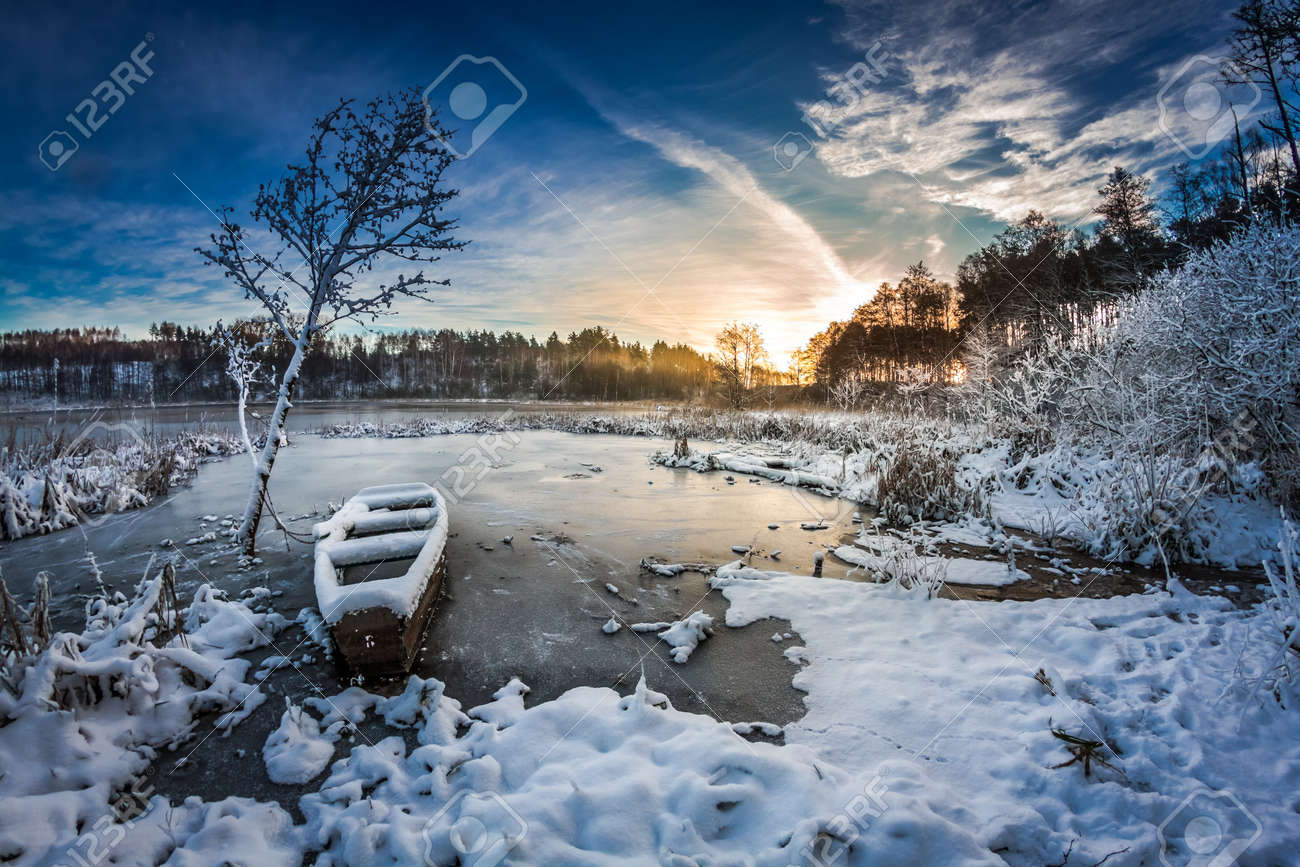 Winter sunrise on the frozen lake Stock Photo - 24565879