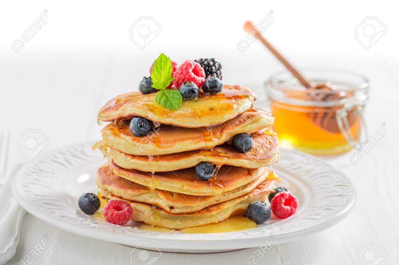 American pancakes for breakfast in the morning on white background - 92859466