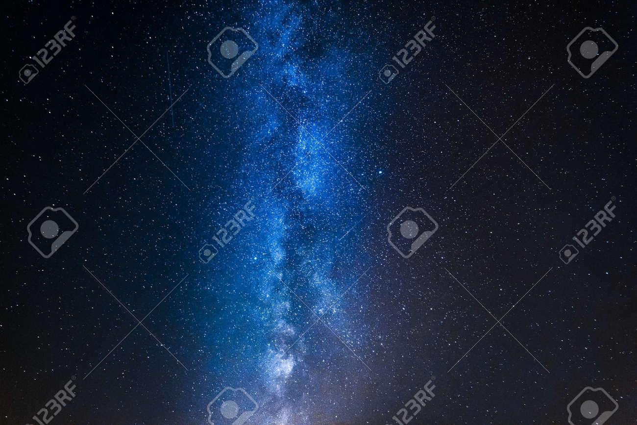 Stunning blue milky way with million stars at night - 107200027