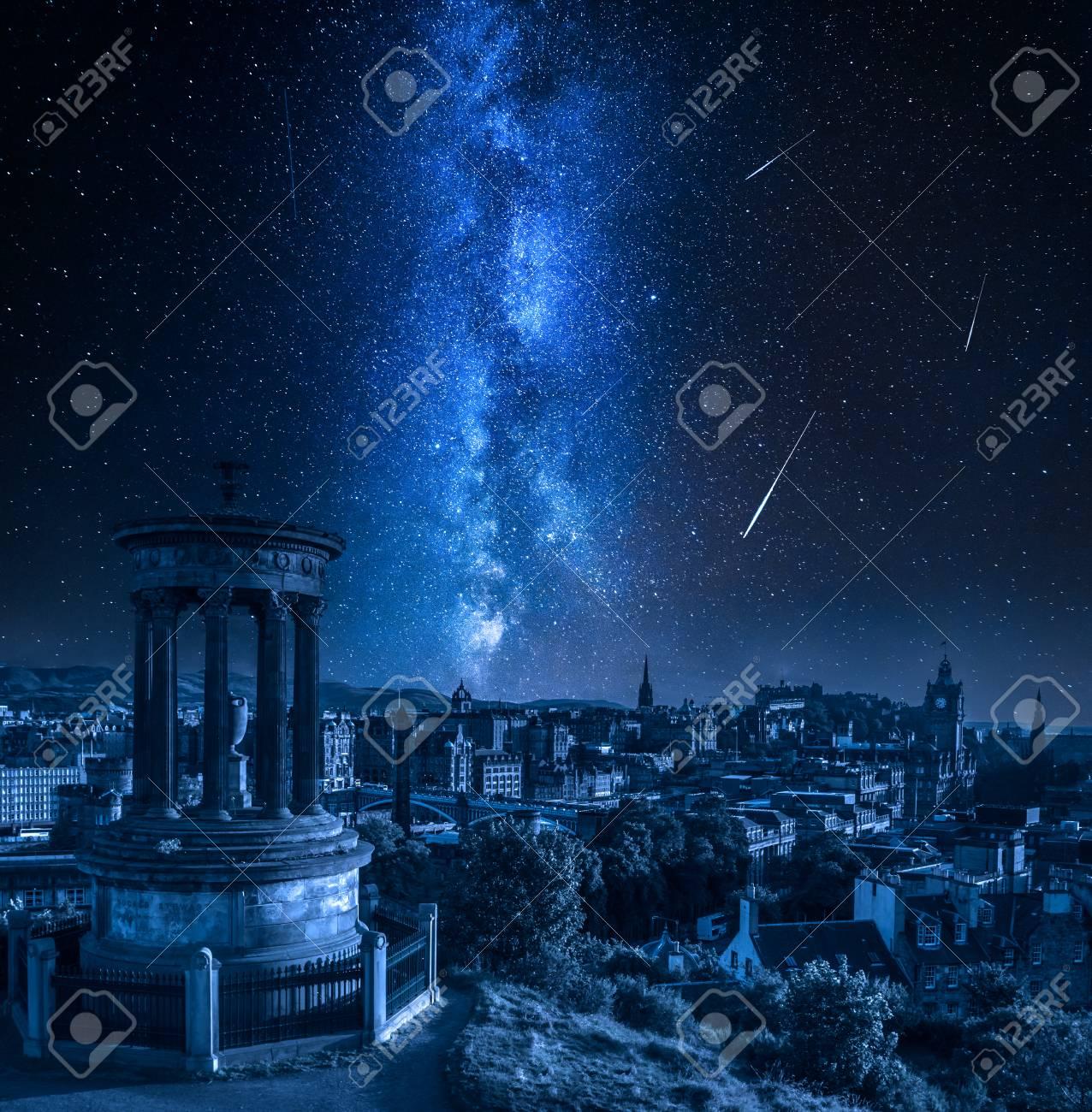 Edinburgh at night with milky way and falling stars, Scotland - 109887398