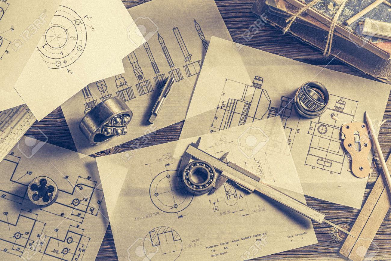 Top view of designer desk of mechanical parts - 126947812