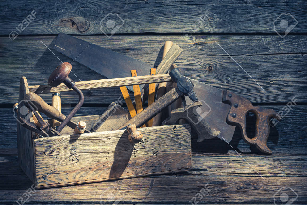 Vintage carpenters box with tools on rustic wooden table - 128701662