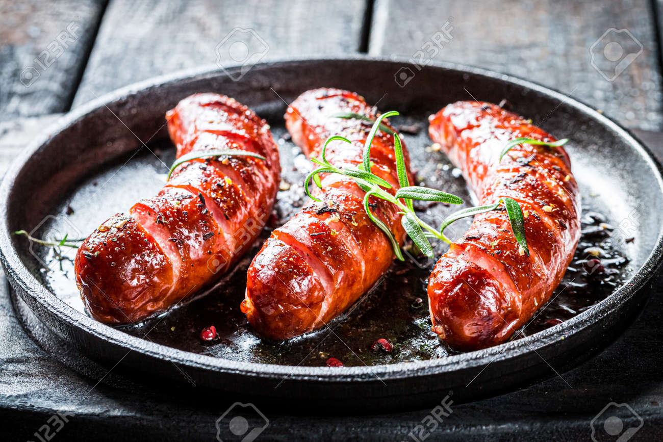 Closeup of roasted sausage with herbs and pepper - 151752439