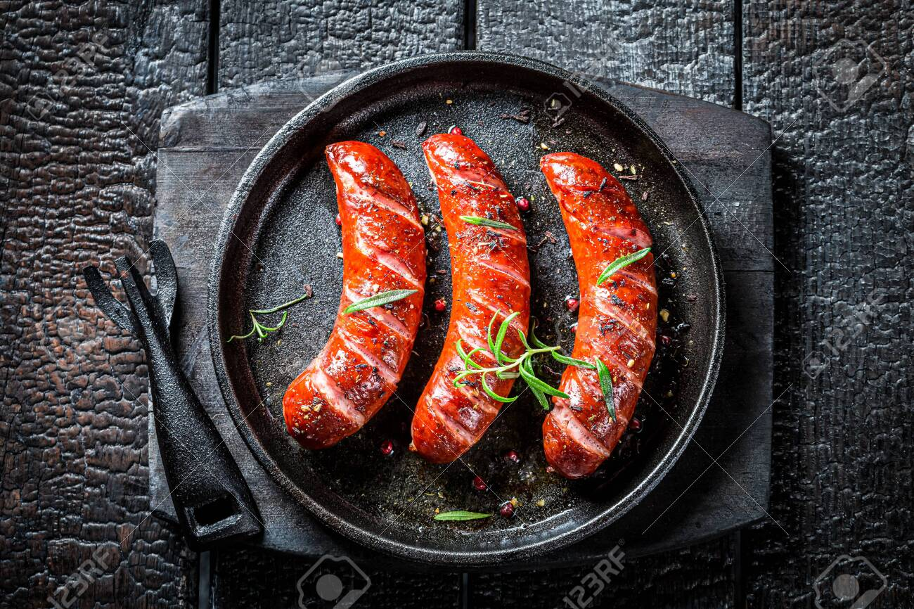 Top view of roasted sausage with fresh herbs - 151752250