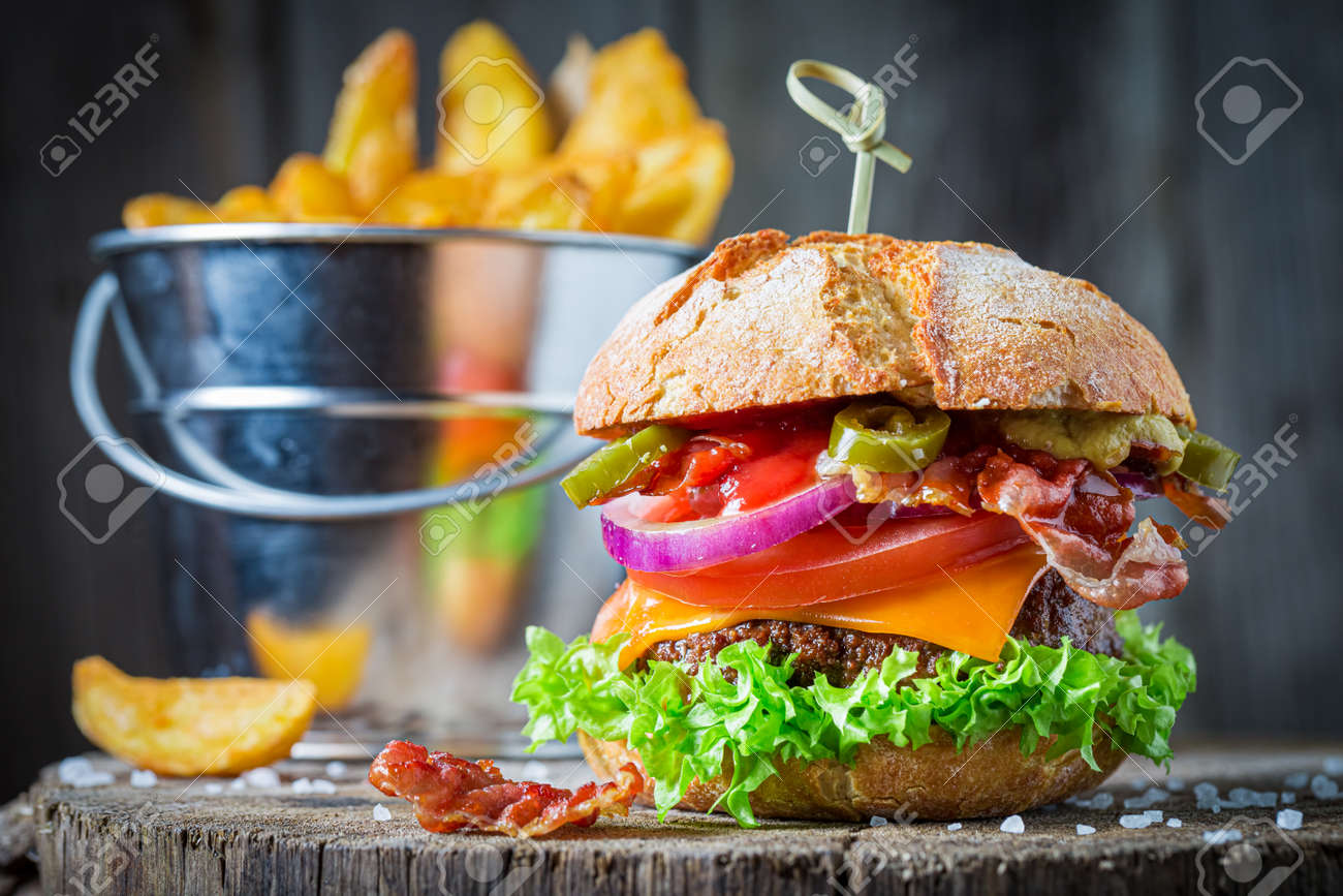 Delicious sandwich made of beef, vegetables and cheese. American cuisine. - 165661463